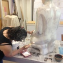 applying gesso to the fiberglass form